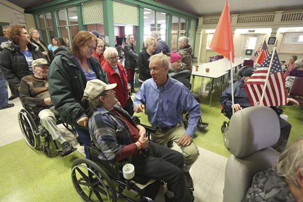 Illinois governor Bruce Rauner at the Illinois Veterans Home in Quincy - AP