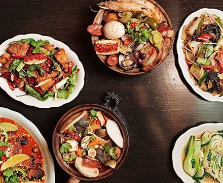 """Some of the great dishes at Fat Rice (clockwise from top middle): arroz gordo (""""fat rice""""), Fat Rice noodle, bok choy with pork stock, balichang catfish, African chicken, and shaking chile whitefish - JEFFREY MARINI"""