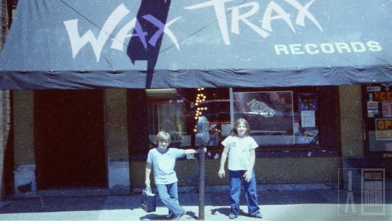 Julia Nash (right) and her brother, Aaron, in front of the original Wax Trax Records on Lincoln Avenue