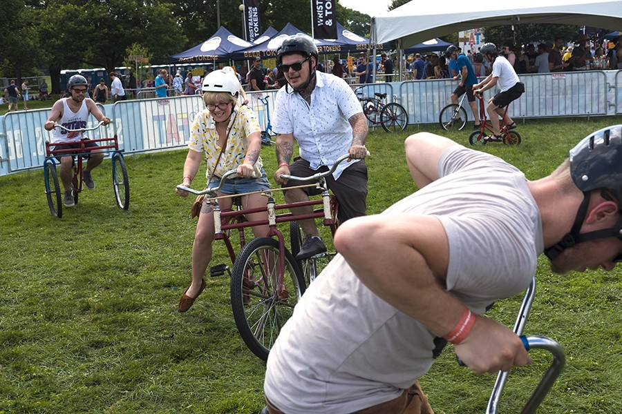 Riders can try out strange and mostly impractical bicycles at the Bike Pit, part of the Tour De Fat Festival in Humboldt Park. - RICK MAJEWSKI