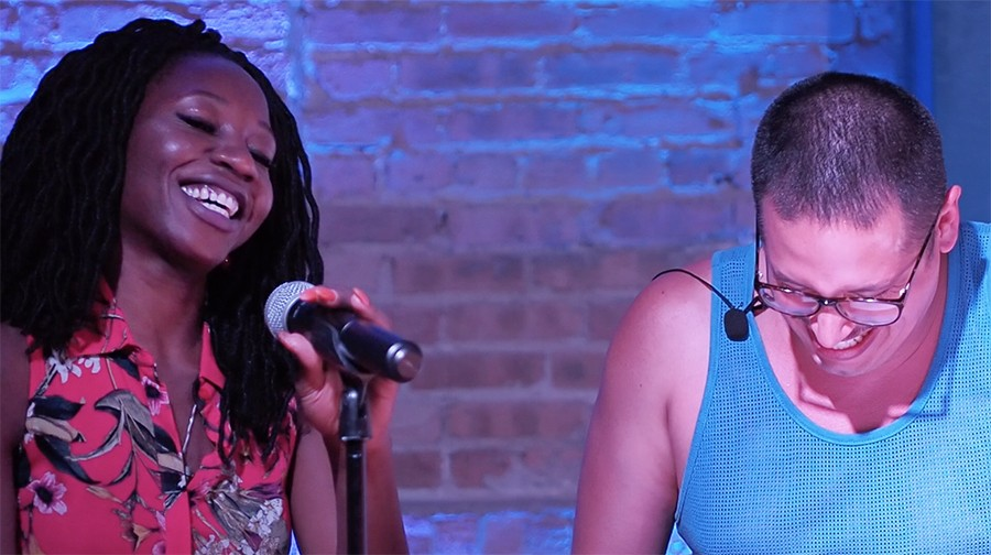 """Hoodoisie creator and host Ricardo Gamboa and featured guest Amara Enyia laugh during Enyia's appearance on the show's """"Make Chicago Wakanda Today"""" episode at Blue Lacuna in Pilsen last May. - HARRY FORBES"""