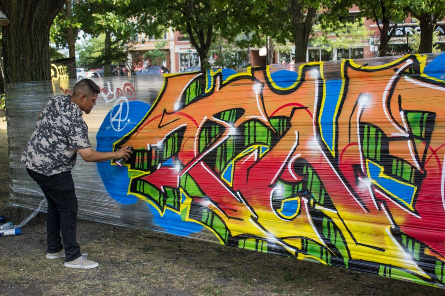 Saib putting the final touches on his entry into the live graffiti competition