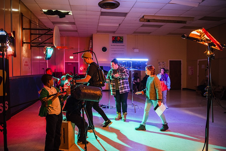 The New Trash crew work on a shot in the gym with the Kidz Express crew—in the foreground,  nine-year-old Trashuwn Jones holds a prop boom mike. - ALLISON ZIEMBA