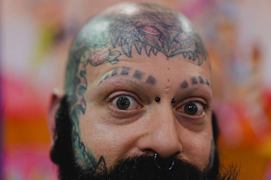"""Randy Pizza Candy, 40, gets himself tattooed every time he travels, he says. He legally changed his middle and last names to """"Pizza Candy"""" because he wanted his son, Vlad Dracula, to carry those names too. - PAT NABONG"""