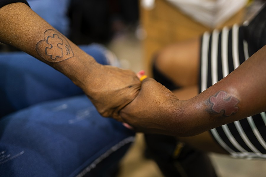 """""""I'm the piece to [my mom's] puzzle,"""" says Aisha Jones, 35, who convinced her 56-year-old mother, Annette, to get her first tattoo. """"We best friends,"""" says Annette. """"We do everything together."""" - PAT NABONG"""