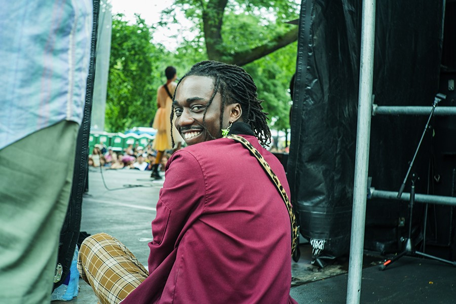 Ric Wilson watches Tasha's Pitchfork performance from side stage. - TIM NAGLE