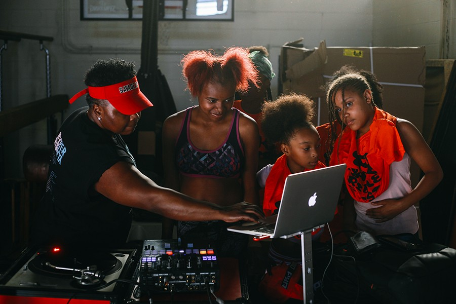 DJ and producer Jana Rush teaches campers how to spin on Circle Up's last day at Robert Taylor Park. - LAWRENCE AGYEI