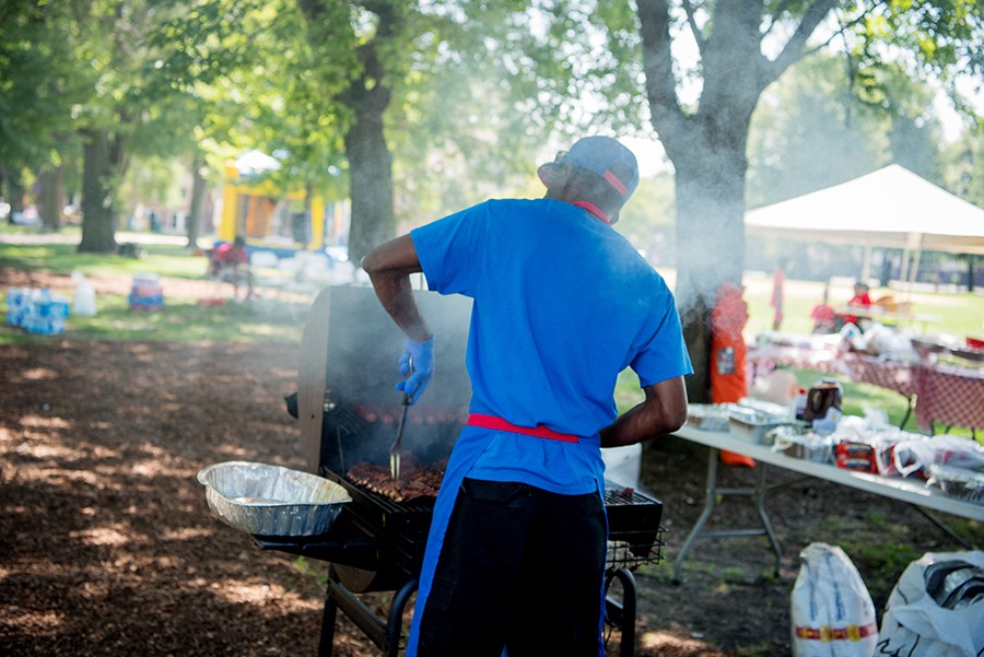 July 13, 2019: Alonzo Carter, 59, barbecues in preparation for a picnic for his church, the Love and Unity Evangelical Church, which was celebrating services in Union Park on a Sunday. - KATHLEEN HINKEL