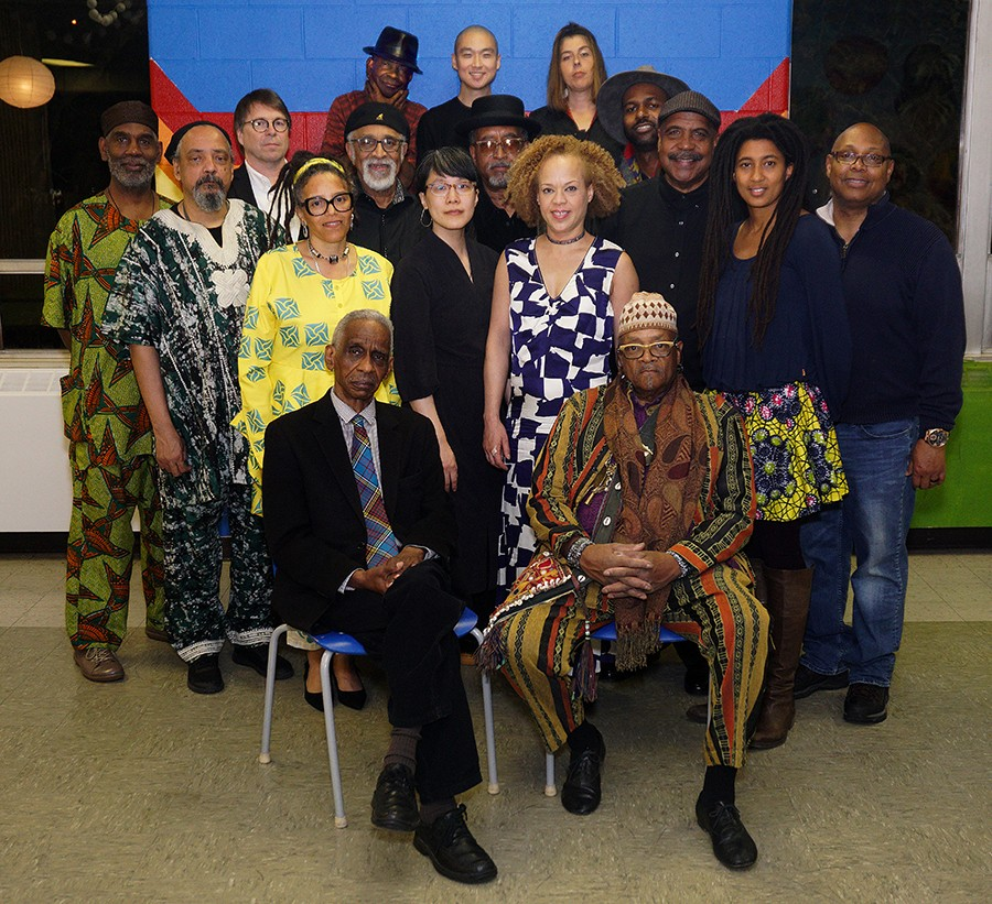 Roscoe Mitchell and Famoudou Don Moye, cofounders of the Art Ensemble of Chicago's famous quintet lineup in the late 1960s, seated before members of the current AEC big band - BARBARABAREFIELD