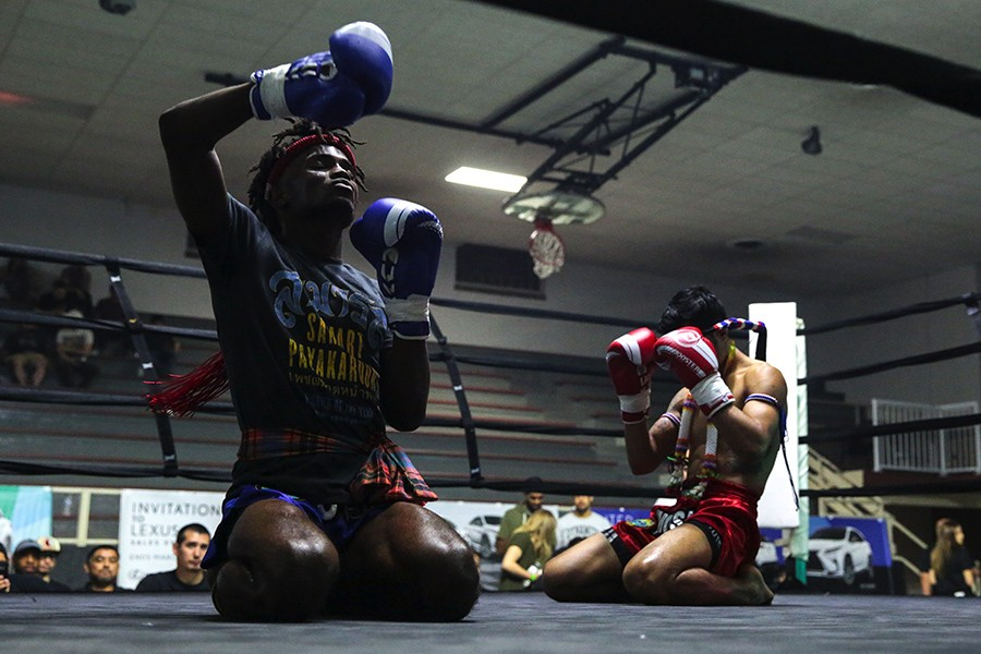 Jalil Barnes (left) and Diego Jagessar perform a wai khru on Sunday, June 2, 2019, at Cicero Stadium. The wai khru is a traditional Thai dance and prayer students perform before fights in order to show gratitude to their teachers, parents, and coaches. - GEOFF STELLFOX