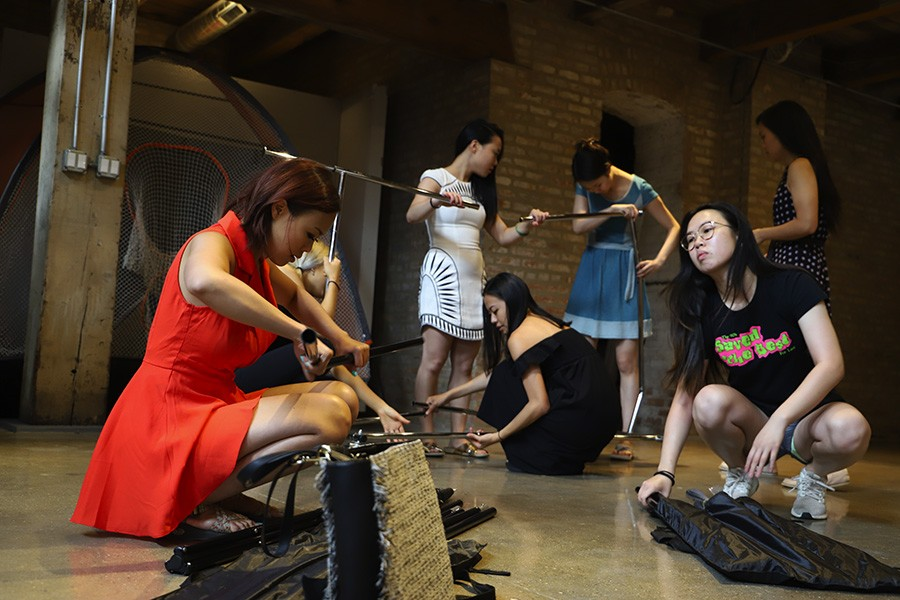 Ng and the contestants set up a makeshift changing room for the last rehearsal before the pageant. The contestants started training as early as February. - CAROLYN CHEN