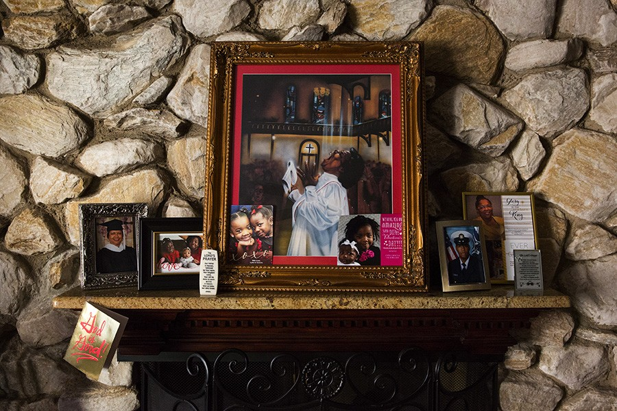 A stylized painting of Mama Lou hangs above the fireplace in her living room in southwest-side Wrightwood. Her niece bought it at a garage sale while on vacation in New Orleans 25 years ago. - GEOFF STELLFOX FOR CHICAGO READER