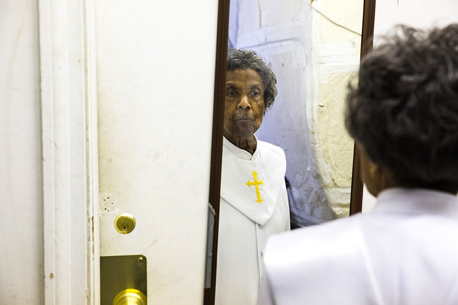 Mama Lou checks herself in the mirror before taking the stage at First Church of Deliverance on Easter Sunday. - GEOFF STELLFOX FOR CHICAGO READER