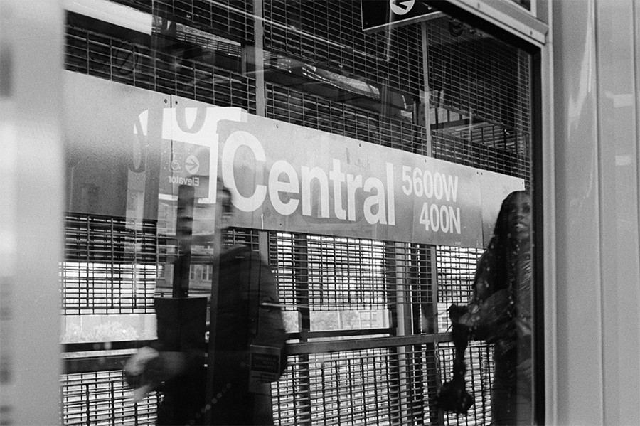 Two commuters swiftly exit at Central. - W.D. FLOYD FOR CHICAGO READER