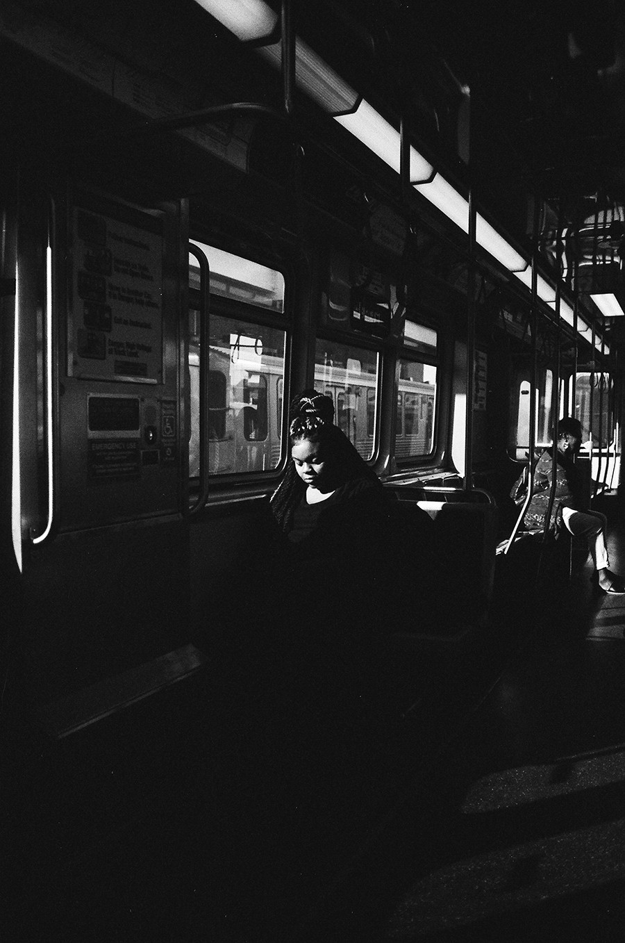 A woman gazes at her phone. - W.D. FLOYD FOR CHICAGO READER