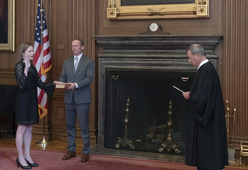 "Chief Justice John G. Roberts Jr. administers the judicial oath to Judge Amy Coney Barrett using a Bible held by Barrett's husband. Barrett's predecessor on the court, Ruth Bader Ginsburg, said just before her death: ""My most fervent wish is that I will not be replaced until a new president is installed."" - FRED SCHILLING / SUPREME COURT OF THE UNITED STATES"