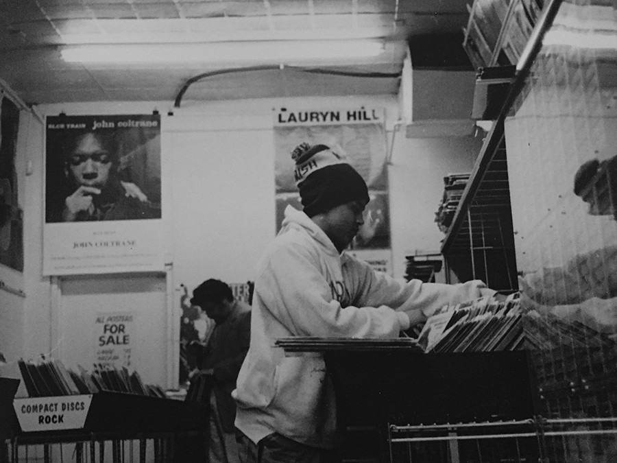 Ibrahem Hasan of Bless the Mad circa 1998, digging through vinyl at Hyde Park Records - COURTESY BLESS THE MAD