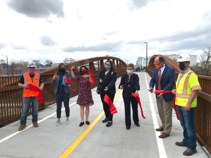 Ribbon-cutting for the Stone Free Bridge. Alderman Silverstein is third from the left. - JOHN GREENFIELD