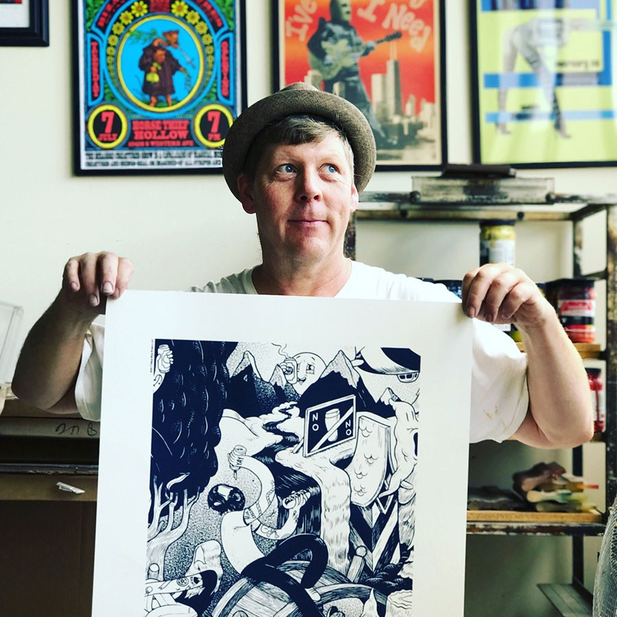 Steve Walters in his studio in 2016, holding an artwork he screen printed for a client. - GREG AYER