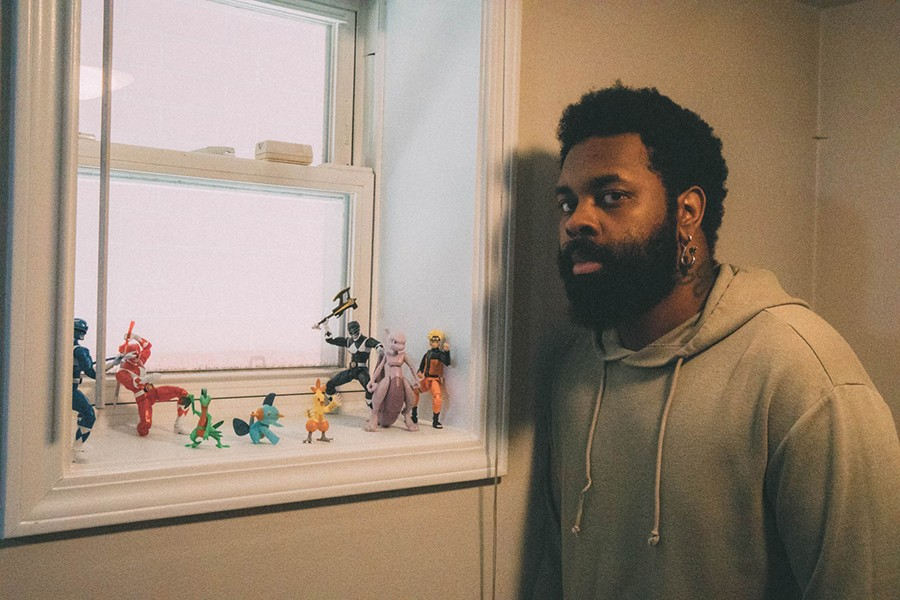 Mohawk Johnson with more of his collection: the Blue and Red Power Rangers, Grovyle, Marshtomp, Combusken, the Black Power Ranger, Mewtwo, and Naruto - ISIAH THOUGHTPOET VENEY AND JADE LANDON