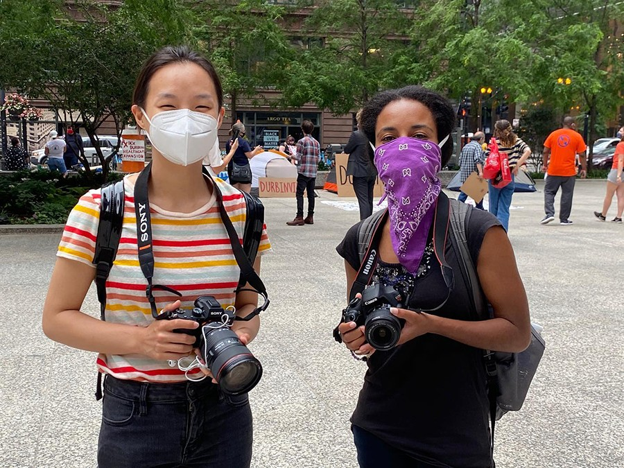 Filmmakers Lily Qi and Sarabi Woods covering events in downtown Chicago for Activism Now. - DAVID A. HOLCOMBE