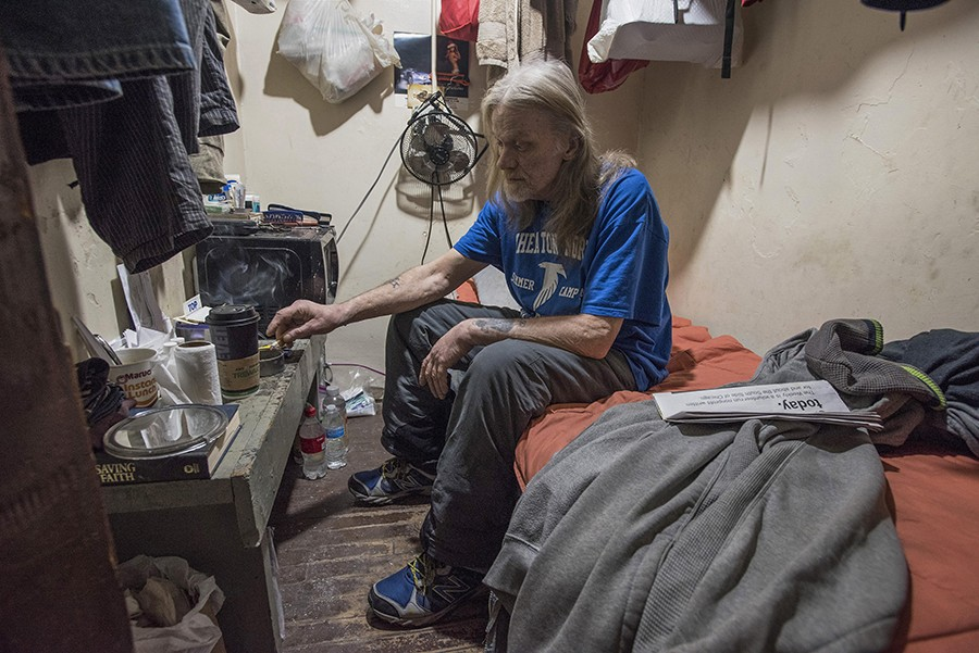 "Bob Boardman, an on-and-off 20-year resident at the hotel, in his room. ""If I didn't have this room I'd be sleeping on the streets somewhere. I've done that. I'd rather be here."" - LLOYD DEGRANE"