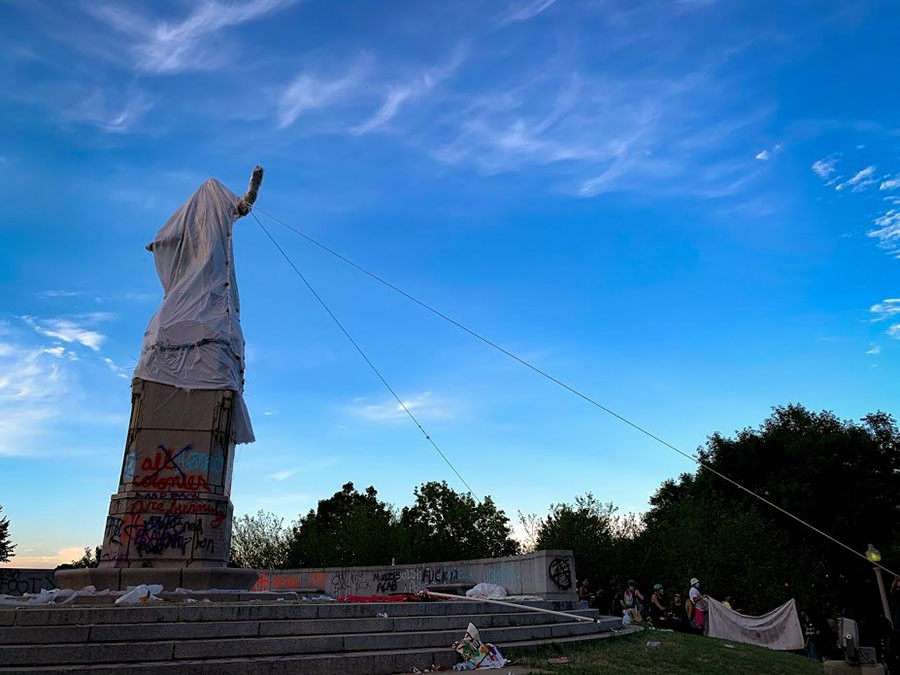 The police used pepper spray to subdue protesters attempting to remove the statue of Christopher Columbus from Grant Park. - GRACE DEL VECCHIO