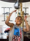 Darrion Davis, 11, practices speed drills in a room connected to the ring. This is usually where new boxers can be found, turning punching bags into a competition.