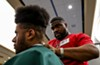 Riverdale resident Michael Leveston, a graduate of Larry's Barber College in Washington Heights, gives his brother Nicholas, 19, a classic  high-top fade.