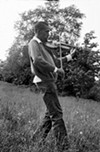 Julius Eastman plays the violin at Griffis Sculpture Park in East Otto, New York, during a 1975 rehearsal by the S.E.M. Ensemble.