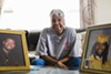 """Eva Early, 73, lives alone in a senior building in Auburn Gresham. A framed photo of her granddaughter and late son are displayed prominently on her living room's center table. The frames normally face the couch. """"They here with me so I could watch them and they watch me,"""" said Early who said she is happy and content with her life even though she does not see her granddaughter often. """"I talk to them ... I just look at the picture sometime and I do, you know, wish he was here and then I look over there and say, there you are there, you know. Hey granddaughter, you know ... I know that if he was in here, he'd be here seeing 'bout his momma, you know. That's it. That's what makes me serious, kinda old and sometimes lonesome. He's not here."""""""