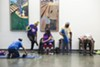 Older adults attend a free yoga class taught by Tony Stevens in the senior satellite center in Abbott Park in Roseland.