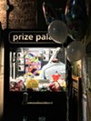Lala Lala filled the venue's claw machine with merch, memorabilia, and trinkets, before their show.