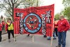 "Members of the Chicago Teachers Union hold a banner declaring ""No Deportations No Anti-Black Racism No Ban"" and ""In Solidarity With Workers"" at the annual May Day march at Union Park, May 1, 2017."
