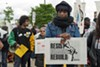 On May 1, 2017, the Resist Reimagine Rebuild Coalition organized a May Day march to draw the connections between racial justice and economic justice. Protesters gathered at Roosevelt and Ogden, between the Cook County Juvenile Temporary Detention Center and Chicago's FBI headquarters.