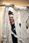Kenyatta Forbes and one of her macrame pieces