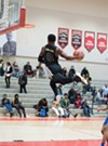 Jacobs with a powerful windmill in a game at Malcolm X College.