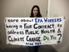 EPA project officer Loreen Targos and the banner she unfurled in protest