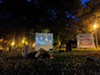 A recent outdoor screening of <i>The Spook Who Sat by the Door</i> at a tent city demonstration