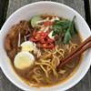 <i>Mee rebus jawa</i>, a dish native to Java, featuring a spicy sweet-potato-and-prawn gravy, with bean sprouts, fried tofu, prawn fritters, and a hard-boiled egg