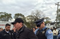 Chain of protesters arrested in a blockade of Koch brothers-controlled pet coke facility
