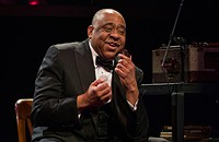 Louis Armstrong takes a complex solo in Court Theatre's <i>Satchmo at the Waldorf</i>