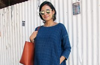 A travel blogger packs a versatile tunic to cover her baby bump