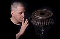 Matthew Duvall organizes the world premiere of a piece that features nearly 100 percussionists