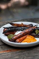 Roasty, beautifully charred carrots are swamped in frothy cream sauce, red wine glaze, and salsa verde. - ANDREA BAUER