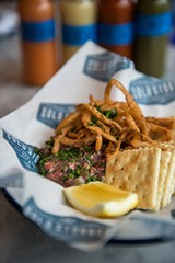 Beef tartare combined with raw oyster meat and topped with crunchy fried onions - JAMIE RAMSAY