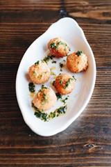 A salt cod brandade awaits in the interior of fritters battered with the brewery's kolsch. - DANIELLE A. SCRUGGS