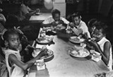 "The exhibit ""Black Panther Party 50 Year Retrospective"" highlights the group's community service work, including a program that provided neighborhood children with free breakfast. - SUN-TIMES PRINT COLLECTION"
