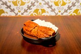 The menu centers on the Mississippi Delta red hot tamale. - NICK MURWAY