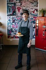 Ethan Lim holding his signature chicken sandwich - JACK X. LI FOR CHICAGO READER